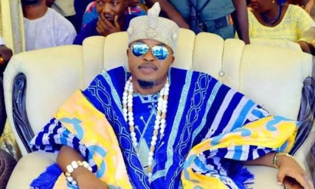 """I'm One Of The People On Earth That Answers The Same Name With God Almighty"" Oluwo Of Iwo Writes As Woman Throws Herself On The Road In Respect, As His Convoy Passes"