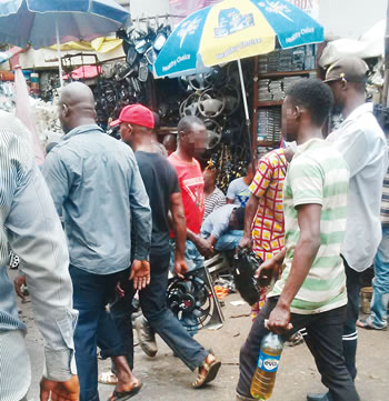 Three Feared Killed As Militarymen Clash With Suspected Touts At Ladipo Market
